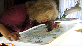 Linda Fairbairn checking Australia Map Journal proof prior to printing