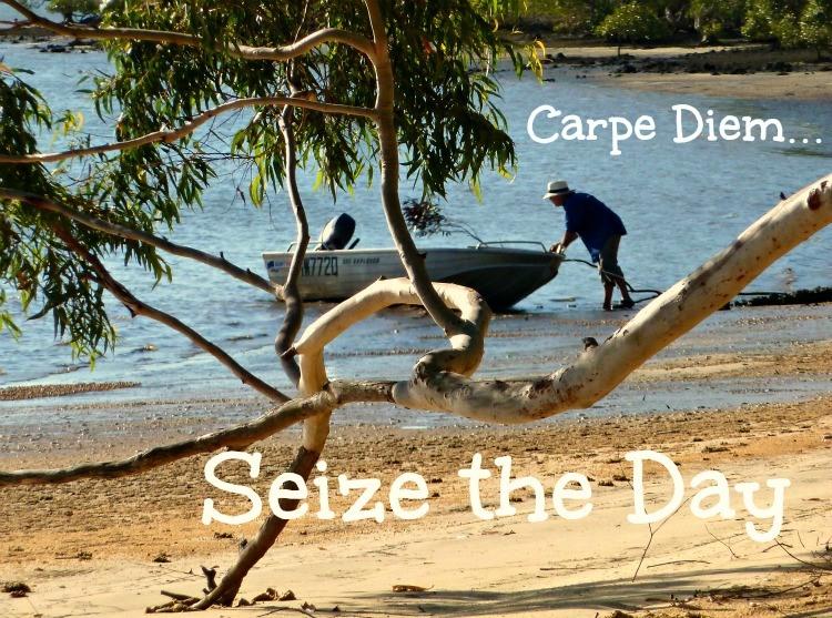 Carpe Diem photo pushing a boat off the beach