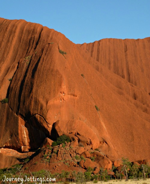 Uluru travel guide - There are areas where the rock folds softly with a surface smoothed by wind and water, and areas where boulders are piled high.