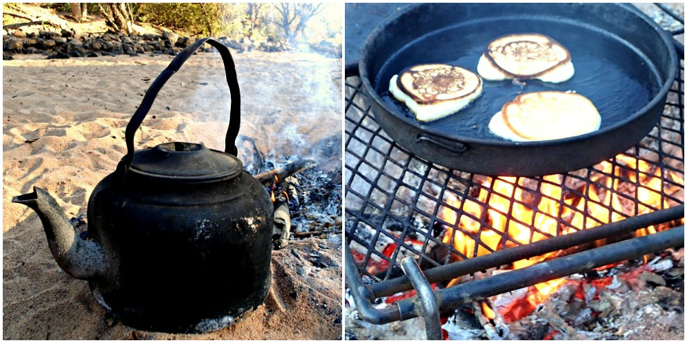 Old black kettle on the campfire with pancakes cooking on the griddle