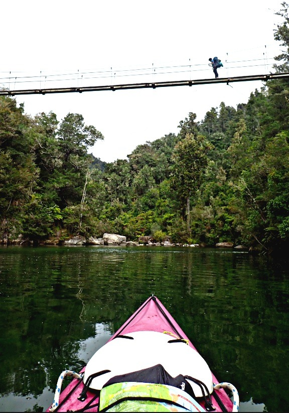 Swing Bridge with a hiker crossing it in the Abel Tasman NP
