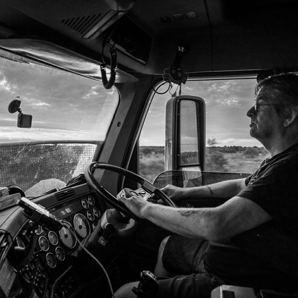 Truck Driver in his cab at the wheel