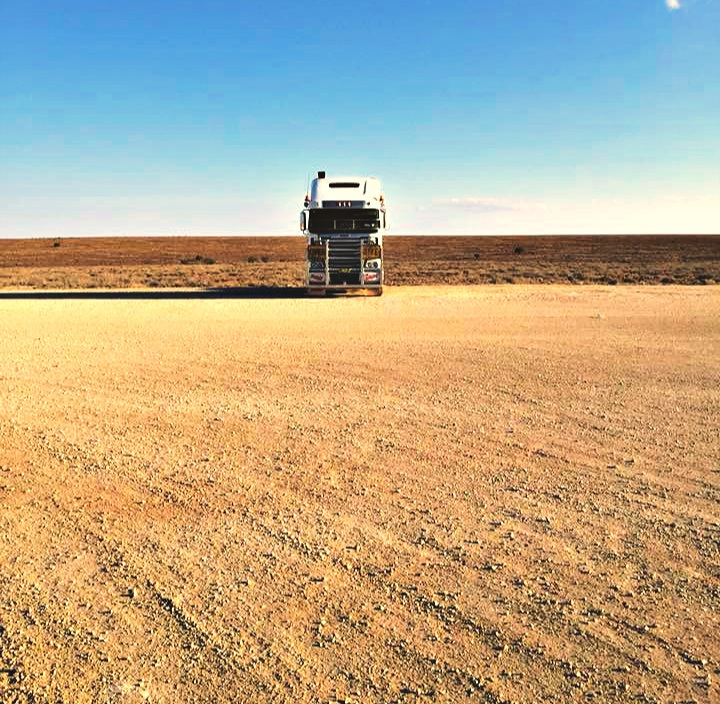 Truck parked on an open plain in Australia