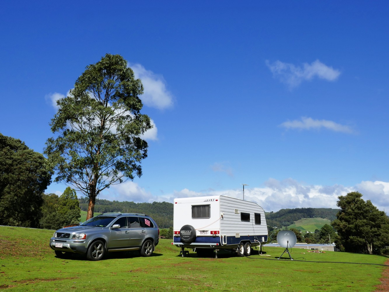 Caravan set in a grassy caravan park